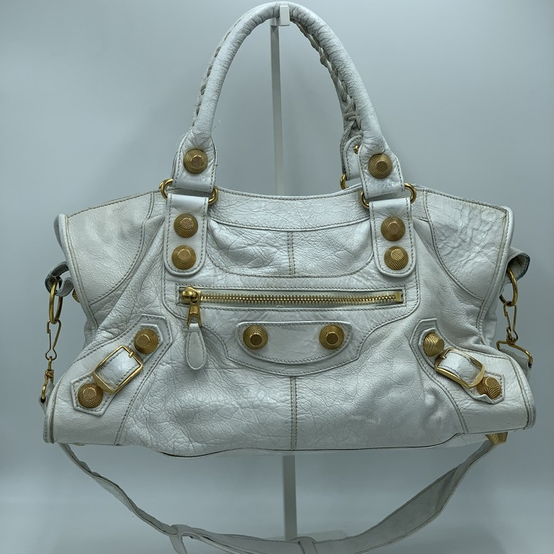 "Balenciaga Motocross, White, Size: OS<br /> <br /> condition: GOOD. wear/leather crackling throughout. wear on handle weaving<br /> <br /> 16""W x 7.5""H x 7.25""D (at base)<br /> 6"" handle drop<br /> 15"" strap drop<br /> <br /> We guarantee the authenticity of every bag on our site. Each bag comes with either an original sales receipt, original tags, or a Certificate of Authenticity from AuthenticateFirst.com. Established in 2013, AuthenticateFirst.com (http://authenticatefirst.com) is one of the premier authentication services in the US, providing authentications of designer handbags, wallets, small leather goods, footwear, jewelry, and accessories. They employ in-house experts who have decades of experience working with hundreds of luxury brands."