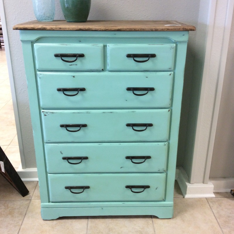 This chest of drawers was manufactured by HARRISON furniture company. It features 6 drawers, 4 of which are quite roomy and has handsome matte black hardware. The top is natural wood, while the rest has been chalk painted a lovely shade of aqua.