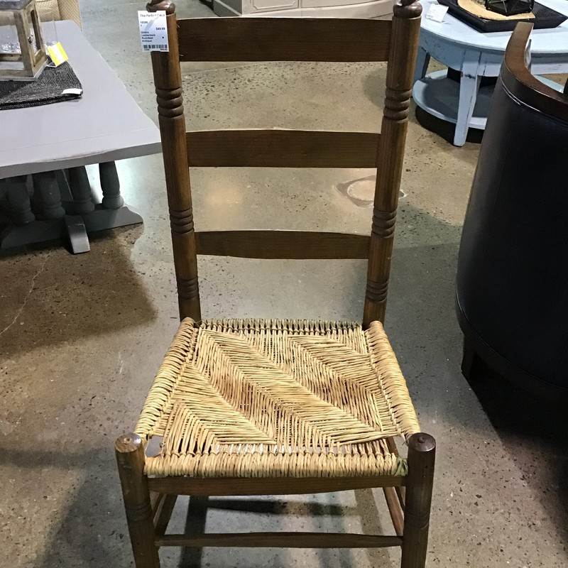 This is a well constructed and sturdy antique ladder back rush seat chair.