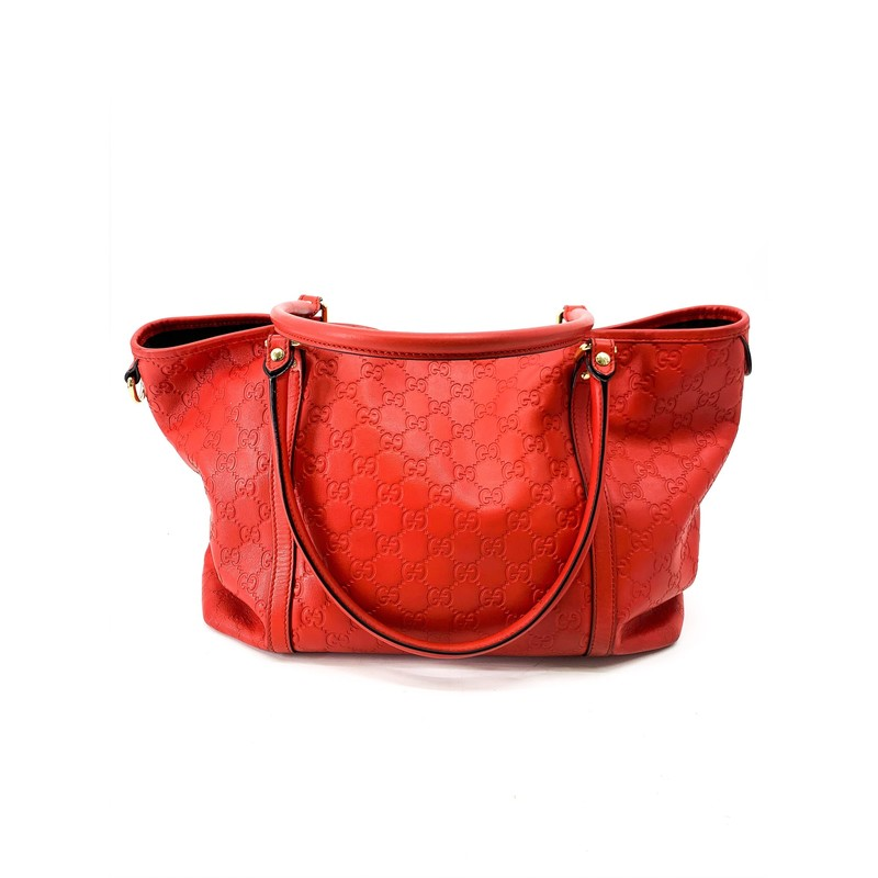 Gucci Red Logo Tote Bag<br /> <br /> DETAILS<br /> - Classic GG embossed<br /> - Solid red in color<br /> - Short handle straps<br /> - Gold hardware<br /> - Easy, on the go bag with such a pretty color!<br /> - Side loop for keychains or scarf accent!<br /> - Condition: Fair...as is, bottom has some discoloration and wear<br /> <br /> MEASUREMENTS<br /> - Height: 9 in<br /> - Width: 7 in<br /> - Legnth: 14 in<br /> - Strap Drop: 9 in