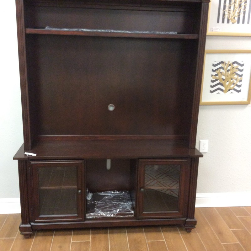 "BARGAIN ALERT!!! This handsome 2 piece television/media center appears to be solid wood and has a rich espresso finish. The large opening measures 53 1/2 "" wide and 35 1/2"" tall (not sure of max TV size that would fit there, as those are measured on the diagonal, and I'm not great at math!). There is an upper shelf and 2 lower cabinets, each with glass doors and a single adjustable shelf. The lower center portion is open and has 2 adjustable shelves. Only $495!!"