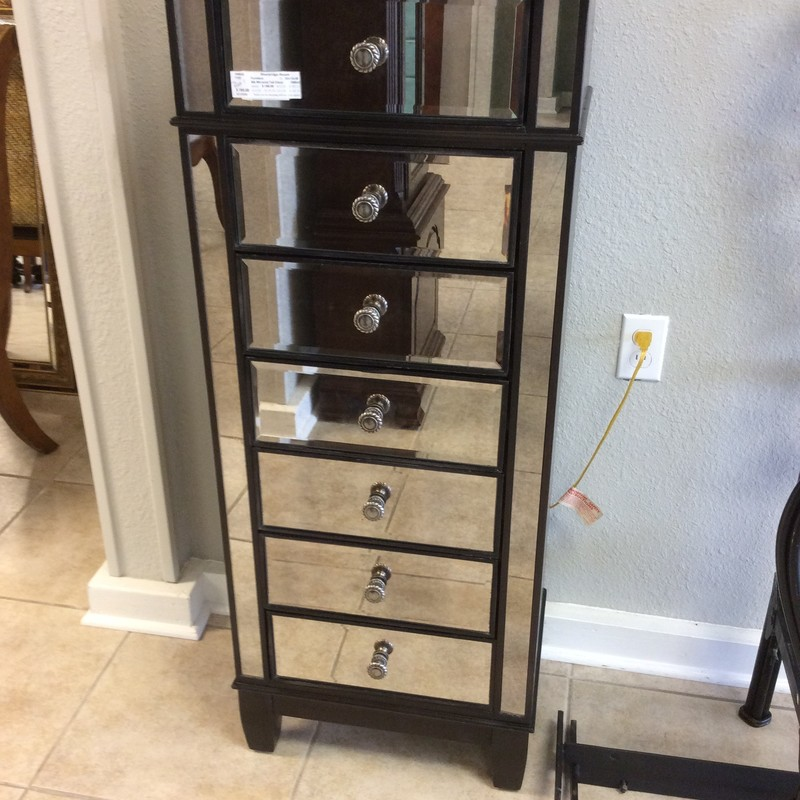 Isn't this a cute PIER 1 lingerie chest? It features solid wood construction with an almost black finish. The mirrored accents on the front are what sets this apart from it's peers. There are 7 drawers, each with a pretty pewter knob. Some of the drawers stick abit, so this is priced to move at only $195.