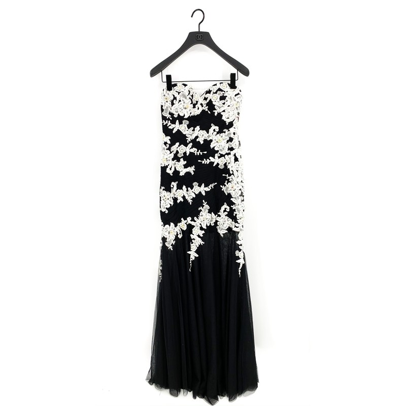 Jovani Prom Dress<br /> -Black and White Floral with gold and gem mermaid style Tool fabric gown<br /> - New With Tags<br /> <br /> MEASUREMENTS<br /> Chest: 28 in<br /> Waist: 26 in<br /> Sleeves: Strapless<br /> Hips: 34 in<br /> Full Length: 58 in