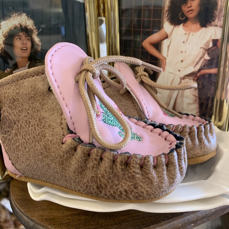 Old West Moccasins, Pink, Size: 1-3 Mo<br /> <br /> How adorable! Perfect for your little one! Sweet embroidered Saguaro Cactus with blooms.  Uppers man made materials. Bottom suede and rubber for no slip traction.<br /> <br /> Free shipping on domestic orders or pick up instore.