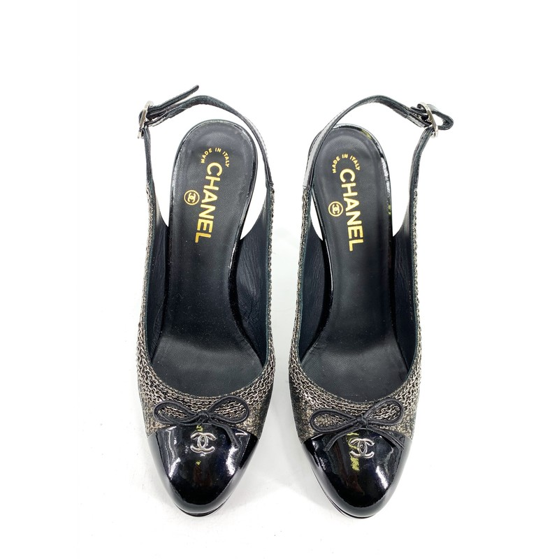 Chanel Black Chain CC Slingback Pumps<br /> <br /> DETAILS<br /> - Metallic fabric with chain detail along the sides<br /> - Black patent<br /> - Slight platform<br /> - Cute bows on toe!<br /> - CC silver detail<br /> - Round toe<br /> - Adjustable slingbacks<br /> - Cut-out on heel<br /> - Condition: Excellent! Some wear on soles, but interior looks great!<br /> - Marked as size 40, fits like a US size 9 1/2<br /> <br /> MEASUREMENTS<br /> - Heel Height: 5 in.