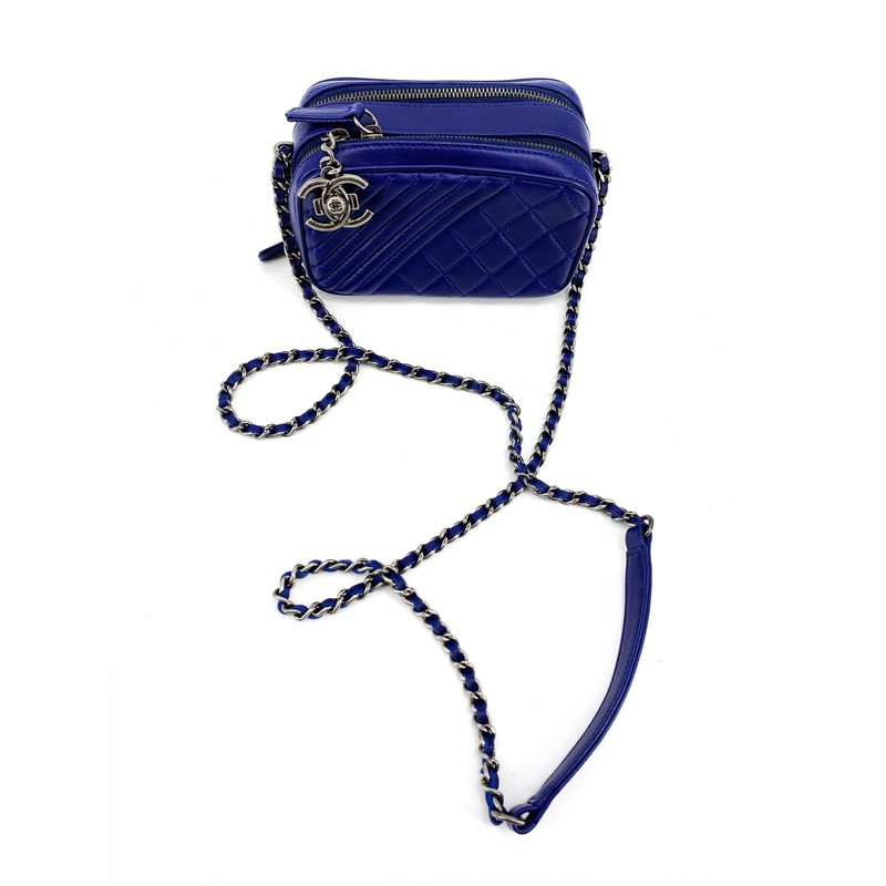 Chanel blue mini Crossbody<br /> - Leather and metal hardware corssbody strap<br /> - Small chanel logo on zipper<br /> - Two openings<br /> <br /> MEASUREMENTS<br /> <br /> HEIGHT: 6 in<br /> Width: 3 in<br /> Srap: 7 in<br /> Length: 9 in