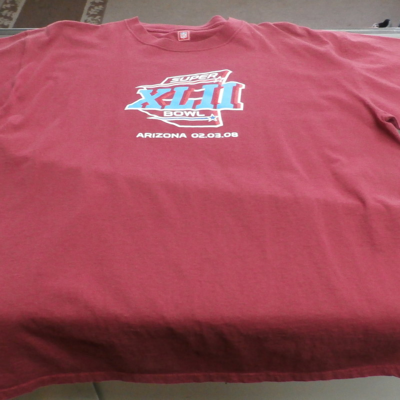Superbowl XLII Arizona Men&#039;s Team Apparel Short Sleeve Shirt Size XL Red #959<br /> <br /> Rating:   (see below) 2 - Great Condition<br /> <br /> Team: n/a<br /> <br /> Event: Super Bowl XLII<br /> <br /> Brand: Team Apparel<br /> <br /> Size: XL - Men&#039;s(Measured Flat: Across chest 24&quot;; Length 30&quot;)<br /> Measured Flat: arm pit to arm pit; top of shoulder to the bottom hem<br /> <br /> <br /> Color: Red<br /> <br /> Style: short sleeve shirt; screen pressed logo<br /> <br /> Material: 100 Cotton<br /> <br /> Condition: - Good Condition - wrinkled; faded and discolored; light stains; pilling and fuzz are present; feels coarse; material is stretched(See Photos for condition and description)<br /> <br /> Shipping: $4.20<br /> <br /> Item #: 959