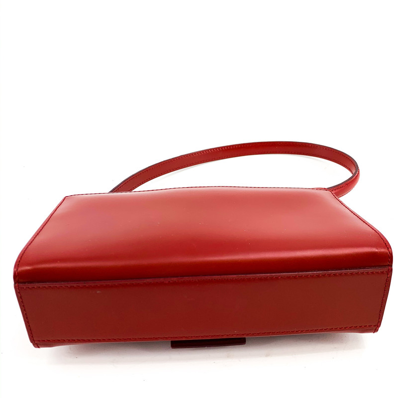 Ferragamo Red Leather Mini Bag<br /> <br /> DETAILS<br /> - Red leather with silver hardware<br /> - Beautiful silver Ferragamo emblem<br /> - Snap closure<br /> - Black Ferragamo embossed interior<br /> - Back open pocket, for your phone or lipstick!<br /> - Condition: Very good! Minor scratches and scuffs on hardware and leather<br /> - Wear as a shoulder bag or on your wrist!