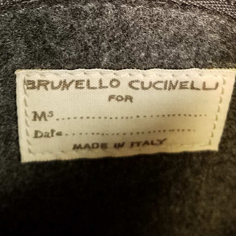 "Brunello Cucinelli Vintage Cross Body Satchel<br /> Amazing textured Vinyl Outer and signature Wool Lining.   This bag shows no wear Mint Condition<br /> The Italian entrepreneur has become known as the 'king of cashmere' for his luxury knits and ethical, sustainable and humanist approach to business.<br /> Purchased for over $2000<br /> 10.75"" x 12"" x 1.5""<br /> Drop 21"" to 25"""
