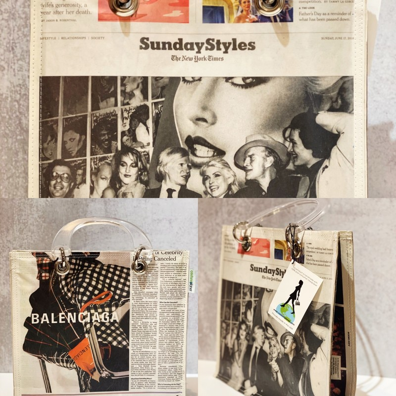 "Balenciaga Newspaper Ad, New, Size: Large<br /> Was $90! The Stella is our largest bag -- measures 11.5"" x 11"" x 4""-  great for a day out touring or shopping.  Snap closure and inside pocket to carry your essentials. About this company:<br /> Couture Planet®, a women-owned business in Lynn, Massachusetts, creates fashion-forward handbags and accessories from 100% post-consumer newspaper. Our products are proudly MADE IN THE USA. Our statement-making bags, bearing headlines from the world of fashion, art, food, travel, sports, and much more, are available in a variety of styles and shapes. We invite you to explore our current collection online and at special events. We also welcome custom orders.<br /> <br /> Each bag tells a special story. ""Newspapers are iconic and historic,"" notes founder, Constance Carman. ""I don't know if people realize what a treasure they are. We are trying to create a green, unique, made in America product that means something special to its owner.""<br /> <br /> Couture Planet® grew out of a recycling project in 2009.  Today we manufacture our product line from a sewing shop in Lynn, Massachusetts. Business partners and owners Kathy Cormier and Michelle Kane are fully committed to creating sustainable products—and business—in the local Lynn community while expanding the parameters of the MADE IN THE USA movement.<br /> <br /> The City of Lynn has a long history as a manufacturing hub, and we aim to honor and grow this tradition. Our bags are sewn by talented artisans in our eco-conscious manufacturing facility. Our repurposed leather straps are made by a family-owned company here in New England. We employ the underserved and mentor students through a local jobs program. We are committed to connect, collaborate, and contribute to our community.<br /> <br /> It is possible to be eco-conscious fashion forward and support our city and country. Our Couture Planet® products represent upcycling at its best.<br /> Recycle, reuse, reduce… RETHINK."