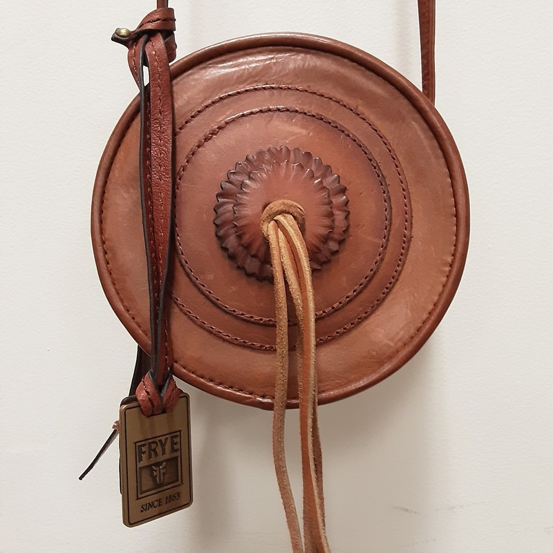 "Frye Crossbody bag with tassel<br /> Strap Approx. 23""<br /> Body Approx. 6"" around<br /> Whiskey in color<br /> Dust Bag<br /> New Scuffed variegated leather<br /> Zipper entry<br /> Brass hardware"