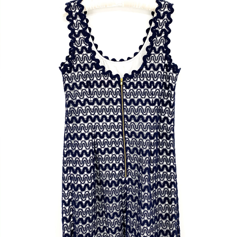 Lilly Pulitzer Navy Lace Dress with White Underneath<br /> <br /> DETAILS<br /> - Navy lace squiggle pattern<br /> - Zip-up back, gold zipper<br /> - Tank dress<br /> - Very slight drop back<br /> - Condtion: Great! Barely worn!<br /> <br /> MEASUREMENTS<br /> - Chest: 36 in<br /> - Full Length: 36 in