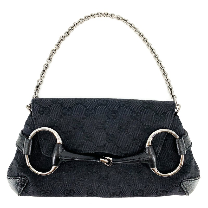 Gucci Vintage Horsebit Black Mini Shoulder Bag with Gunmetal Chain<br /> <br /> DETAILS<br /> - Black canvas bag, GG stitch<br /> - Silver/gunmetal hardware<br /> - Horse buckle on front<br /> - Chain, shoulder strap<br /> - Condition: Very good! Usual vintage wear<br /> - Wear as an adorable mini shoulder bag or on your wrist!<br /> <br /> MEASUREMENTS<br /> - 10 in. across<br /> - 6 in. long