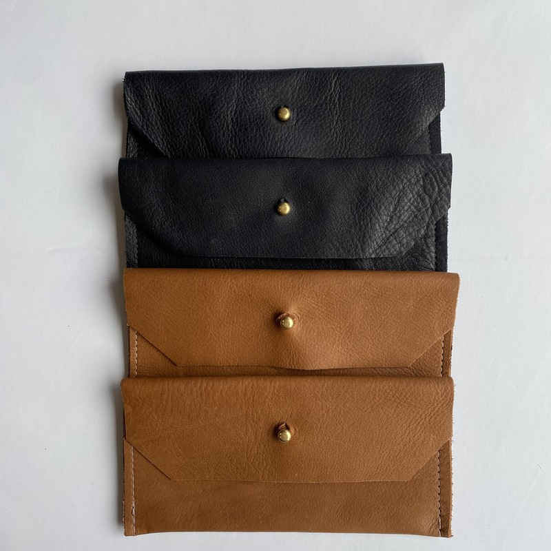 "Wallet<br /> Created Beautifully<br /> Reclaimed Leather/Hide<br /> 7""x3.5""<br /> See sizes for color"