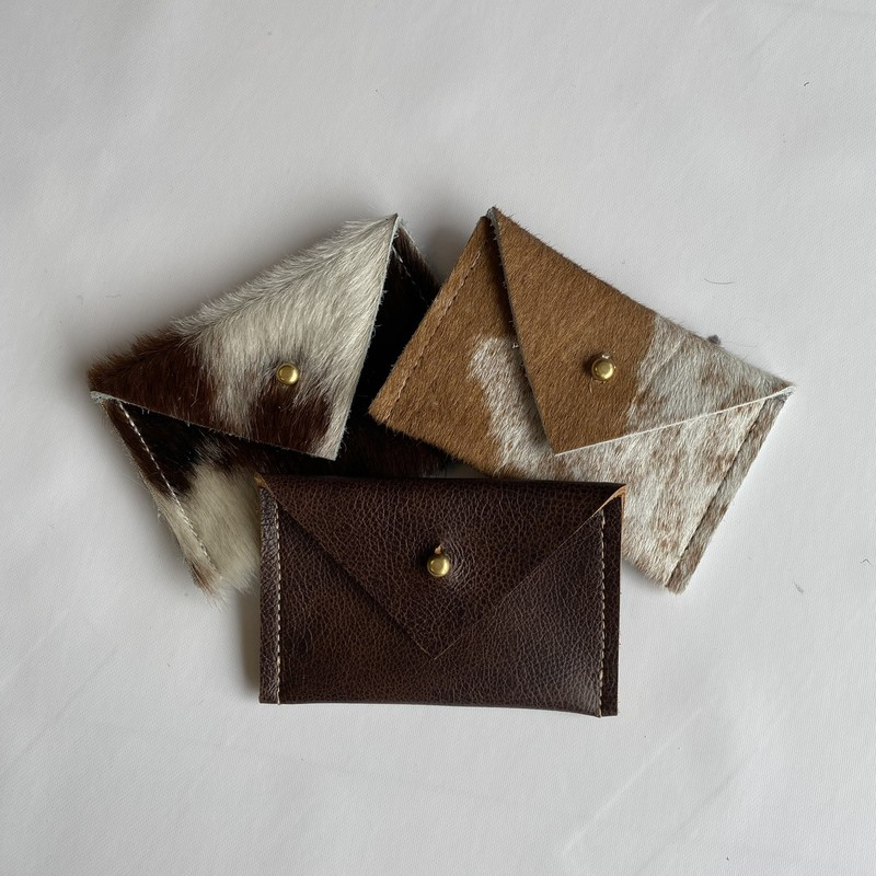 "Wallet<br /> Created Beautifully<br /> 4.5""x3""<br /> reclaimed Leather and hide<br /> See sizes for colors"