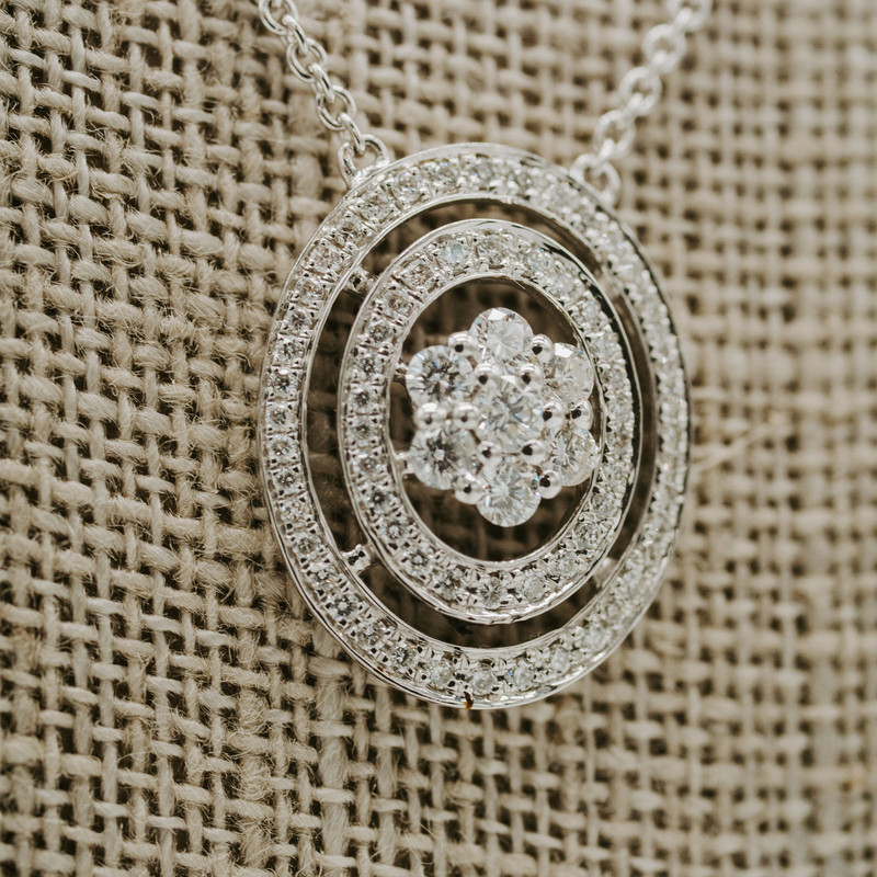 14k white gold 3/8 carat oval Cluster necklace with diamond accents