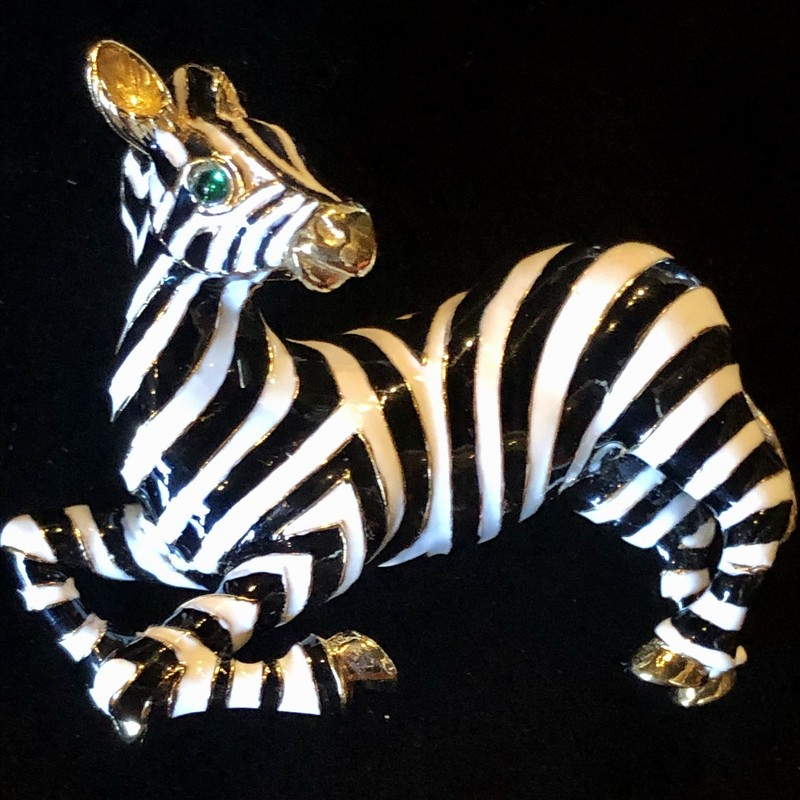 "This is a Vintage Ciner Zebra Brooch, gold plate & enameled with green eyes. It's 2 3/4"" x 2\"" and is in perfect condition.<br /> Ciner was founded in 1892, first producing fine jewelry then transitioning to costume jewelry in 1931. All the work was still done by hand. Ciner was known for using 18k gold plating, high-quality glass beads and stones, & rich enameling giving the jewelry a substantial feel and longevity in wear. This emphasis on quality is why costume jewelry collectors prize vintage Ciner pieces today."