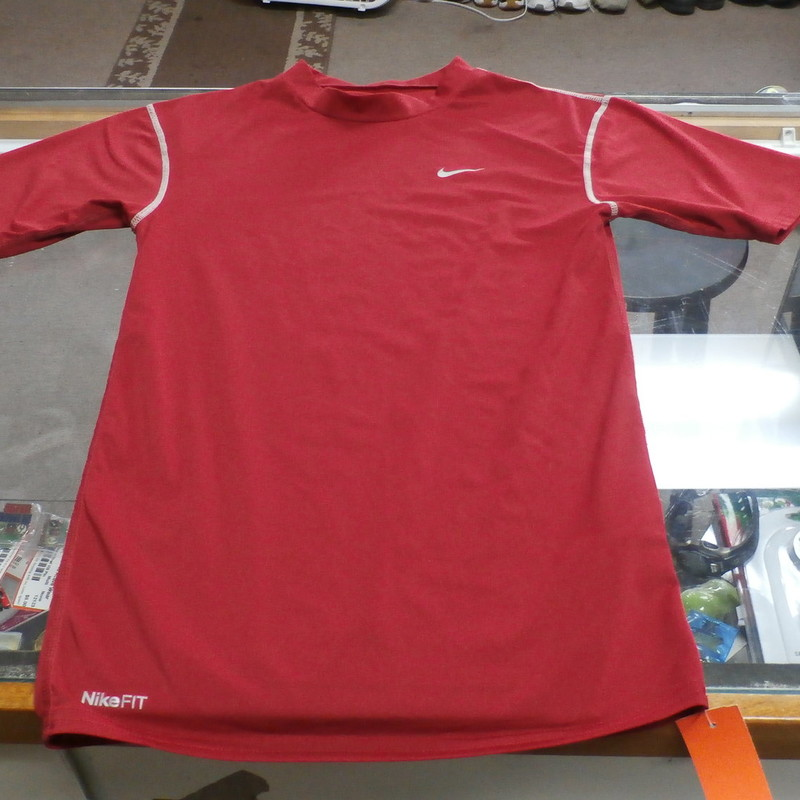 "Nike Pro Fit Dri Men's Compression Short Sleeve Shirt Size Small #14497<br /> Rating:   (see below) 2 - Great Condition <br /> Team: n/a<br /> Player: n/a <br /> Brand: Nike<br /> Size: Small - Men's(Measured Flat: Across chest 14"", length 25"")<br /> COMPASSION FIT - FITS TIGHT TO THE SKIN<br /> Measured flat: arm pit to arm pit; top of shoulder to the hem<br /> Color: Red <br /> Style: Short sleeve compression fit; dri fit<br /> Material: 84 Polyester  16 Spandex<br /> Condition: - Great Condition - wrinkled; material looks and feels great; light fuzz; no stains rips or holes; neck tag slightly worn; (PLEASE SEE PHOTOS)<br /> Item #: 144957<br /> Shipping: $3.37"