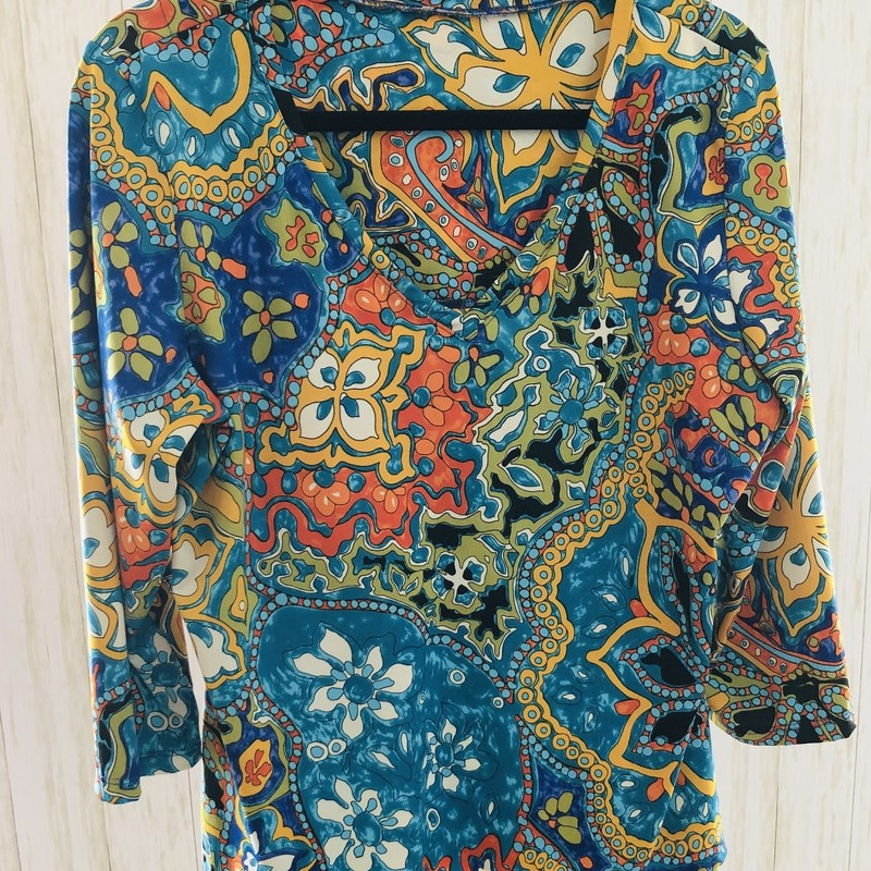 Wild print, flattering V neckline, 3/4 sleeves.  More of a nylon feel than cotton - probably Lisette!  Fun!