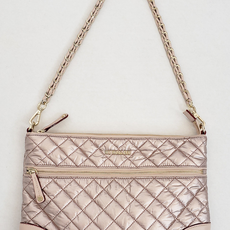 MZ Wallace<br /> Metallic Rose colored<br /> Quilted crossbody<br /> With Attached Pouch<br /> 3 straps included - One chain, One Leather<br /> Seatbelt style