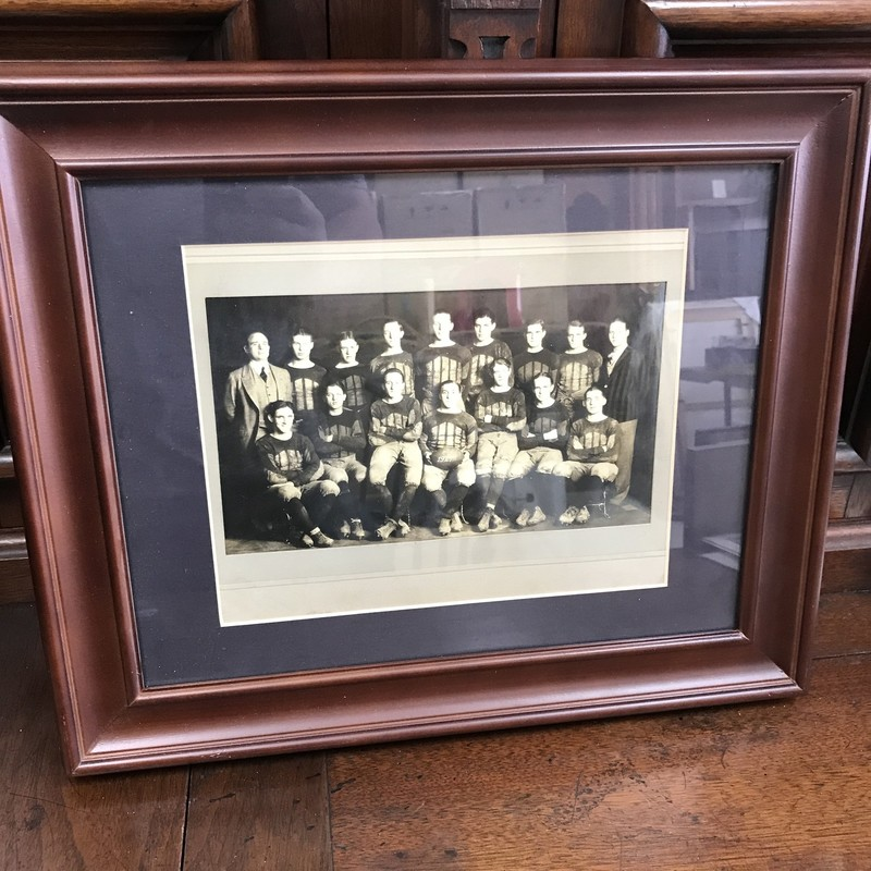 "True antique photo of 1927 football team put in modern frame. Approx 18""x15"""