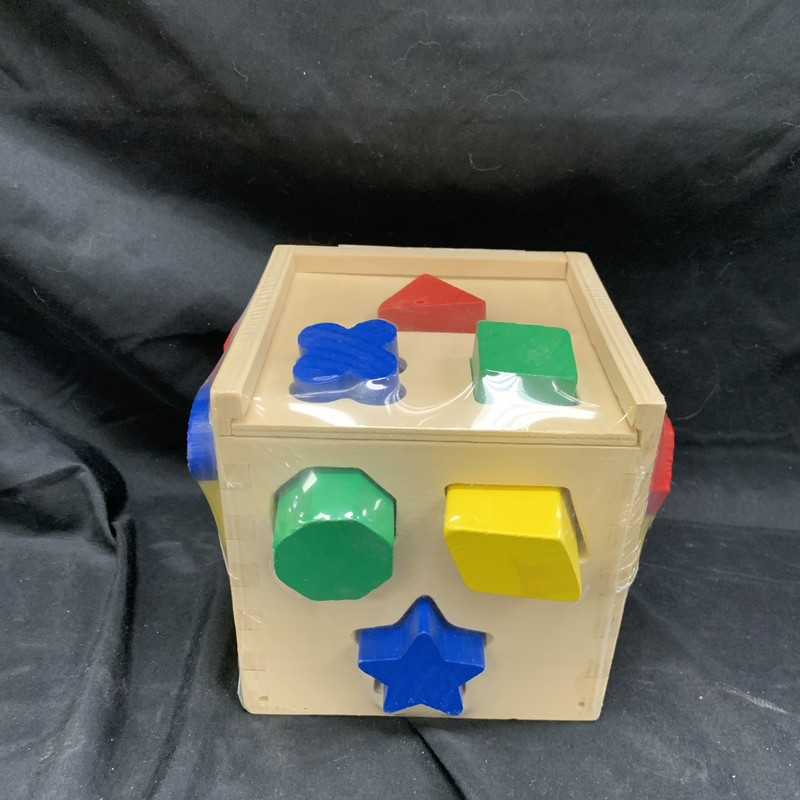 Shape Sorting Cube, Wood, Preschool<br /> Ages 2+<br /> 12 wooden shapes<br /> Helps teach sorting skills, colour and shape recognition and fine motor skills; encourages problem solving and manual dexterity