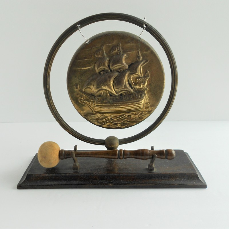 This beautiful antique bronze gong will bring history into your home. The background is a majestic golden barque.