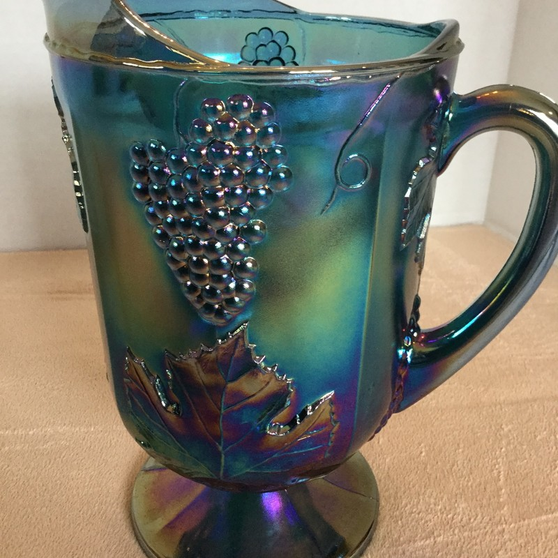 Blue/green carnival glass pitcher. No chips; perfect condition!