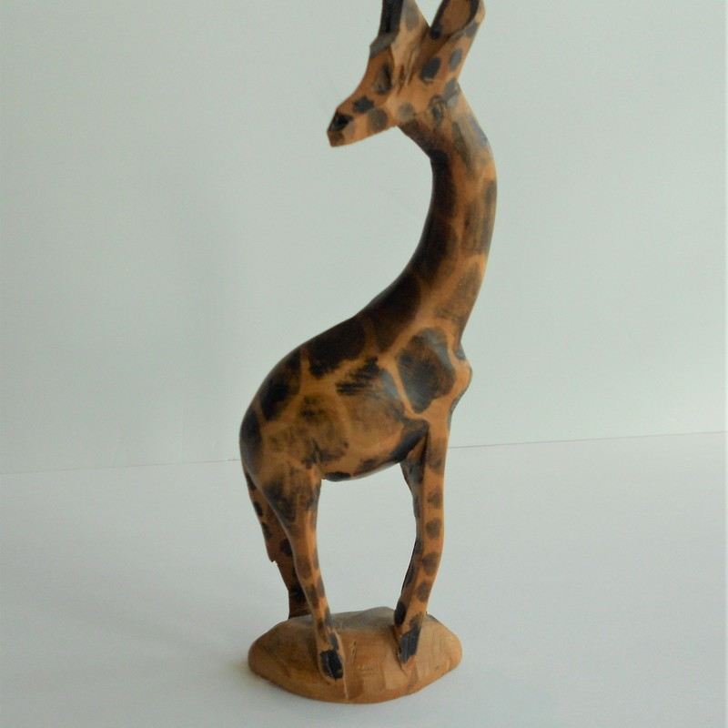 "Hand carved in Kenya. 8"" tall"