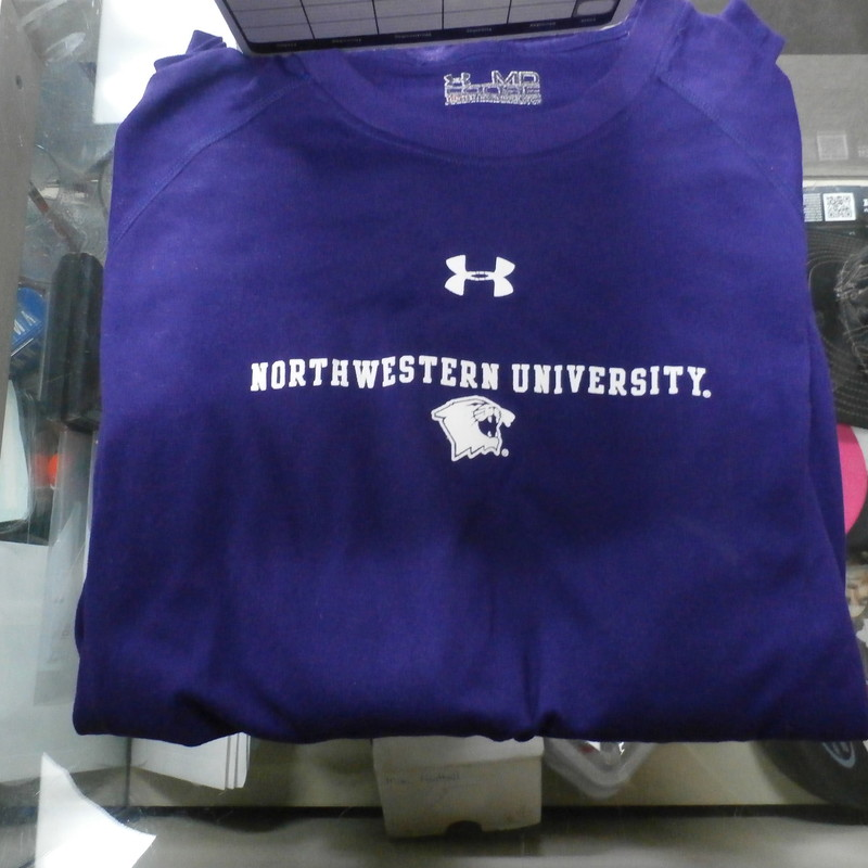Northwestern Wildcats Under armour Adult Long Sleeve Shirt Medium Purple #15798<br /> Rating: (see below) 3 - Good Condition<br /> Team: Northwestern Wildcats<br /> Player: Team<br /> Brand: Under armour<br /> Size: Men&#039;s Medium -  (Measured: Across chest 21&quot;, length 28&quot;)<br /> Measured: Armpit to armpit; shoulder to hem<br /> Color: Orange<br /> Style: screen pressed logo; Long sleeve shirt; Loose Fit; Heat Gear<br /> Material: 100% Polyester<br /> Condition: 3 - Good Condition; wrinkled; pilling and fuzz; feels coarse; few cracks; logo looks great; screen pressed tag is worn and hard to read; some light stains; normal signs of wear; no rips or holes<br /> Item #: 15798<br /> Shipping: FREE