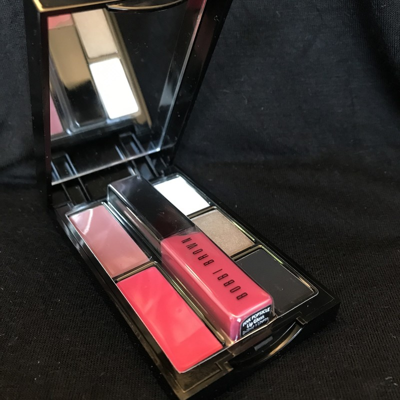 NEW<br /> <br /> <br /> Case has some minimal marks. See pictures<br /> <br /> <br /> <br /> The palm-sized Atomic Pink palette takes the guesswork out with a perfectly edited selection of eye and lip shades that are fresh; fun and quintessentially Bobbi.<br /> Palette features: - Three Eyeshadows including the limited-edition shade; Eclipse; that doubles as an eyeliner; as well as shades White and Cement. - Two Lip Colors including Atomic Pink; a limited-edition shade sure to make lips pop; as well as Pale Mauve. - A mini Lip Gloss in Pink Popsicle that easily clicks right into the compact. Limited edition. By Bobbi Brown.