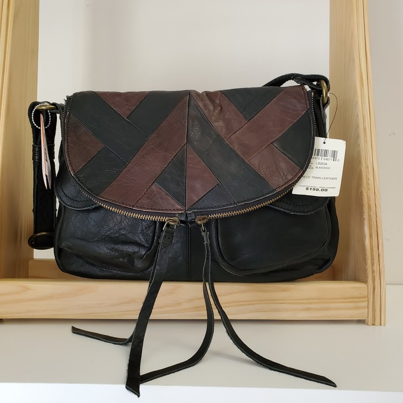 Lucky Brand<br /> Piece Train Leather<br /> NWT Retail $198.00<br /> Adjustable Crossbody<br /> Black and Chocolate<br /> Fold over magnetic closure