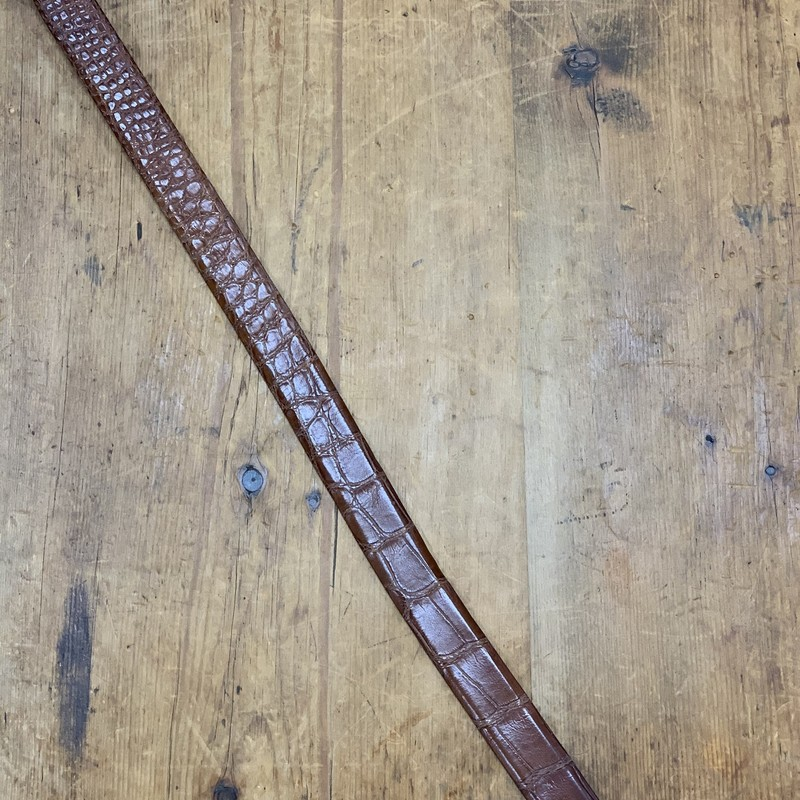"Beautiful Genuine Louisiana Alligator belt from Stanley Korshak<br /> DOES NOT INCLUDE BUCKLE<br /> Color: Cognac<br /> Size: 36 ""<br /> Condition: Excellent, minor bowing in the middle"