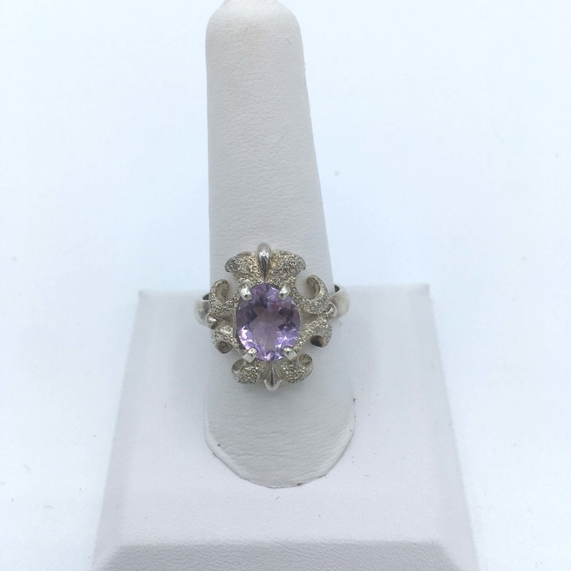 Item#737<br /> Amethyst Ring in an Ornate Sterling Silver setting,<br /> Size - 10<br /> Price - 69.00