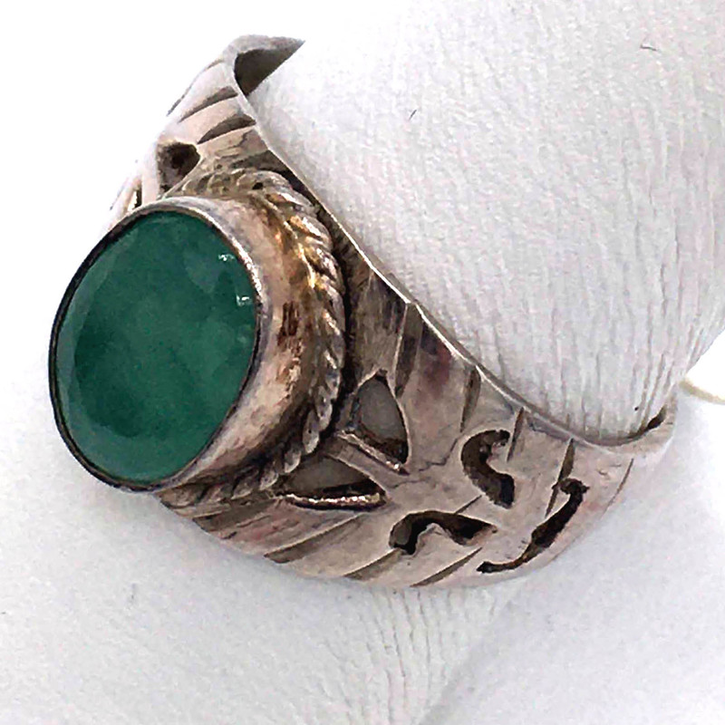 Item# 735<br /> Jade Ring in a  Carved Sterling silver setting<br /> Color - celadon,<br /> Size: 8.5<br /> Price - 69.00