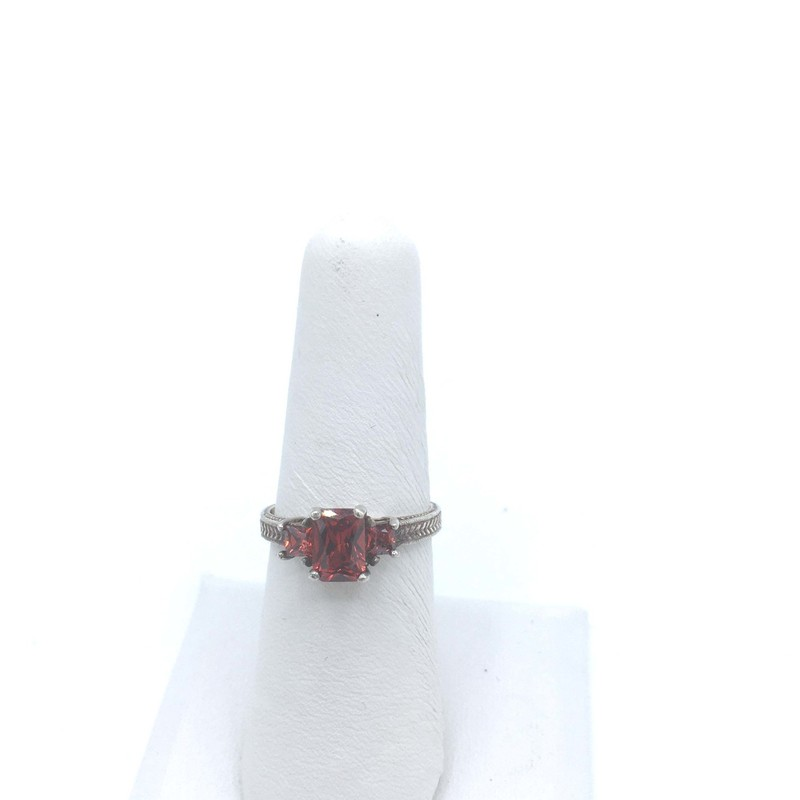 Item#734<br /> Tri Red Ruby Ring In Sterling Silver Filigree  Setting<br /> Color -  Red,<br /> Size: 7<br /> Price - 198.00
