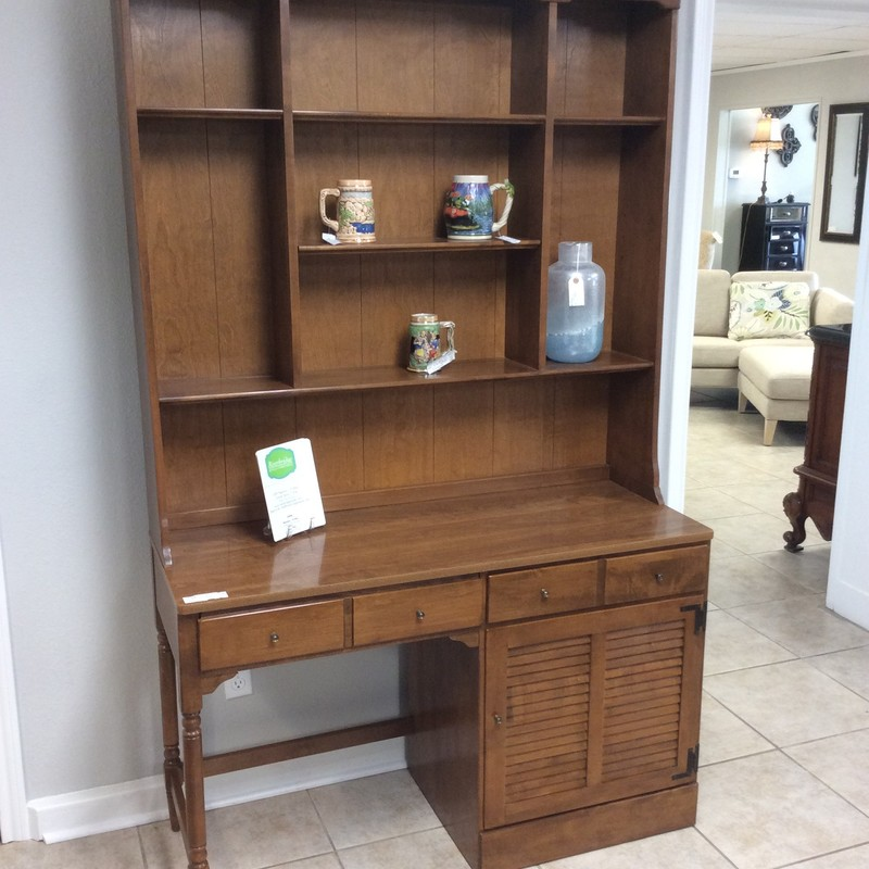 This computer desk is by Ethan Allen and can handle all of your technology needs! Constructed of fruitwood with a laminate desktop it includes a desk and a hutch. The hutch features 3 tiers providing plenty of storage/display space. The desk has 1 drawer with a divider system and a pull-out keboard tray.