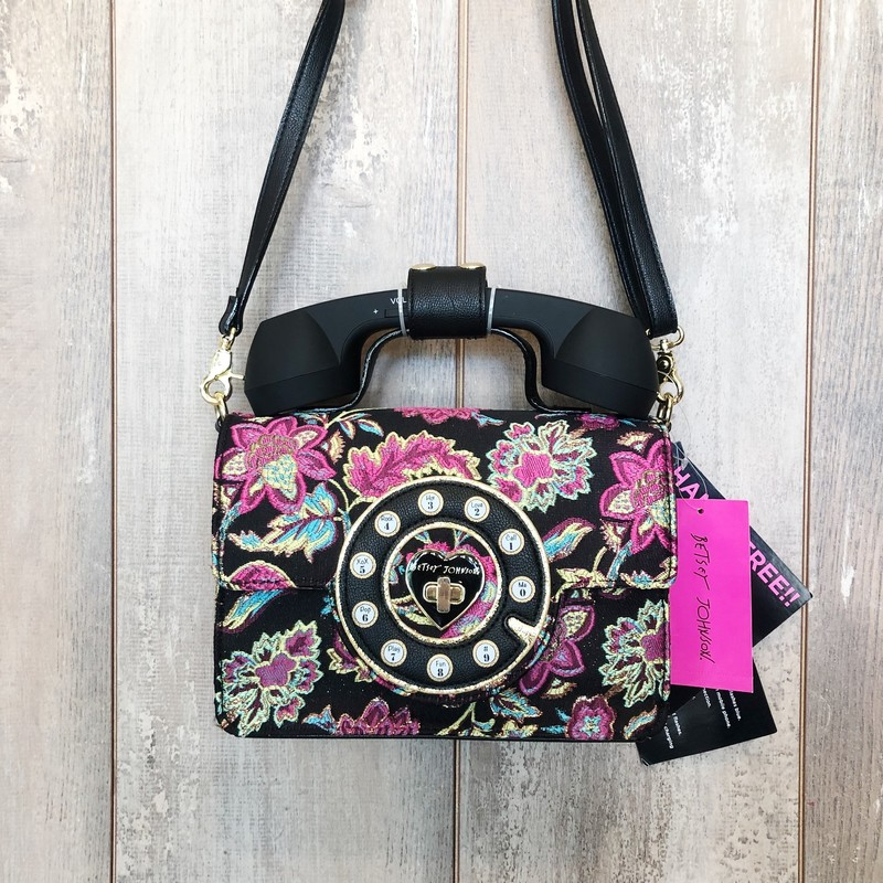 "New with tags!<br /> <br /> Calling all Betsey Johnson lovers!  How fun is this crossbody!? Not only does it look like a retro rotary phone- the headset actually works! It's bluetooth enabled and will connect to your phone! Now you can chat with your gal pals in style!<br /> <br /> Approx. 8-3/4""L x 3""W x 9-1/2""H with a 2""L handle drop and a 24""L adjustable crossbody strap."