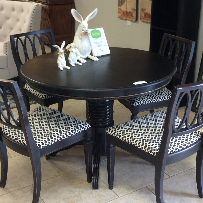 "This is a darling little set. It all appears to be solid wood and has a black finish. The table top measures 41"" across and there are pretty antiqued gold<br /> details around the apron. The 4 sturdy chairs have pretty carved backs, each with 3 metal medallions on them, and black/white patterned upholstered seats."
