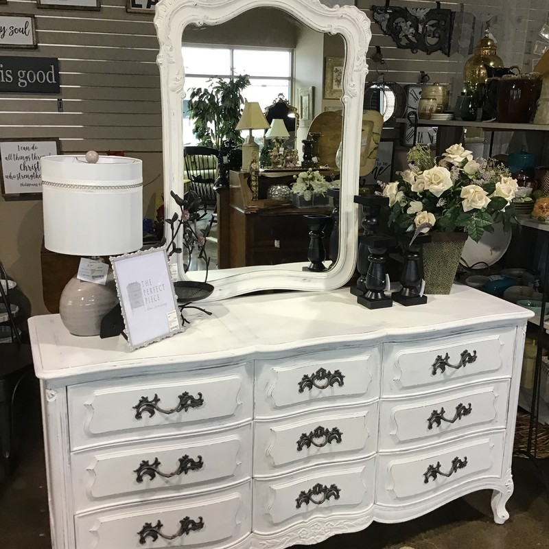 "This long dresser with attached mirror was painted in-house using Country Chic's Simplicity (white) paint, distressed and clear waxed. The handles were updated with a deep charcoal spray paint. There are 9 large drawers and the piece is extremely well-made. The drawers are all dovetailed and the piece is solid wood. Great updated piece for any bedroom!<br /> Dresser Dimensions are 65"" x 21"" x 34""<br /> Mirror Dimensions are 30"" x 45"""