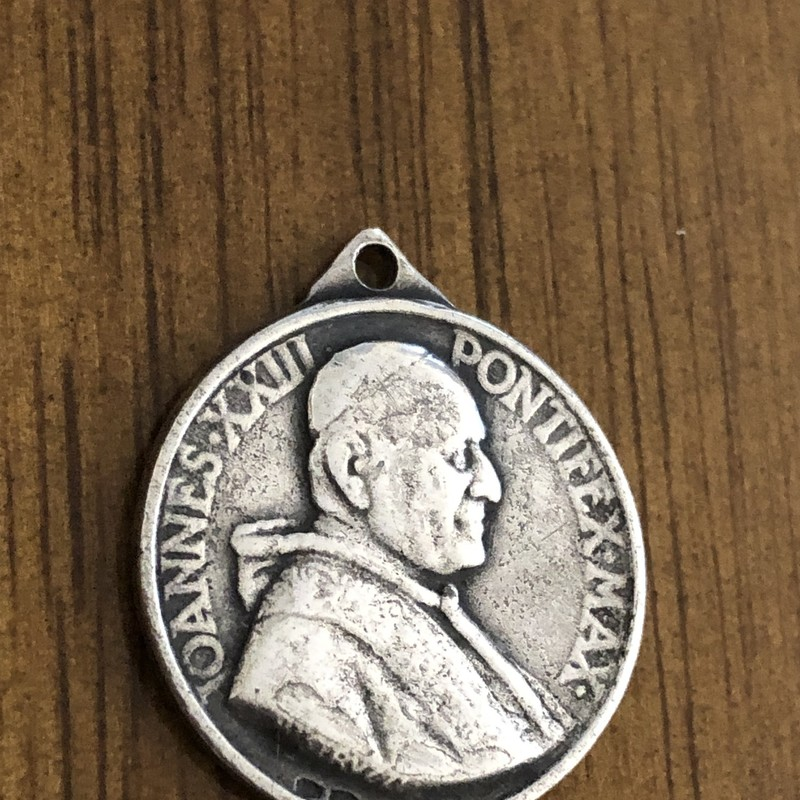 Joannnes XXIII Pontifex Max silver religious Medal. The pope is on one side with Mary ,Baby Jesus & 2 angels on the other. Good vintage condition with just the right amount of aged patina.