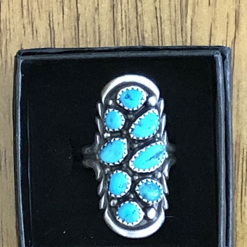 Vintage ring by Navajo jeweler Wilford Nez, who is known for his nugget jewelry. It's set with 8 different turquoise nuggets in saw tooth bezels with silver bead accents. Signed W. Nez. Size 9.