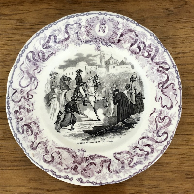 "French Napoleon Commerative Assiettes Parlantes Plate. c.1840s ""From the top of the Monuments""<br /> Assiettes Parlantes, or talking plates, are French transferware plates with sayings on them. The most collectible illustrate the life of a French hero such as the plates depicting Napoleon. Really unusual to find in purple. 8"""