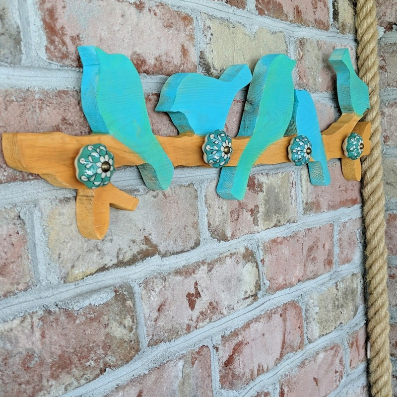This whimsical, hand cut, hand painted, Birds on a branch silhouette wall hanging is so cute and functional too!<br /> Truly one of a kind. Use to hang your hats; totes; car keys or anything else you can think of.<br /> Featured at Be Kind Creative Designs