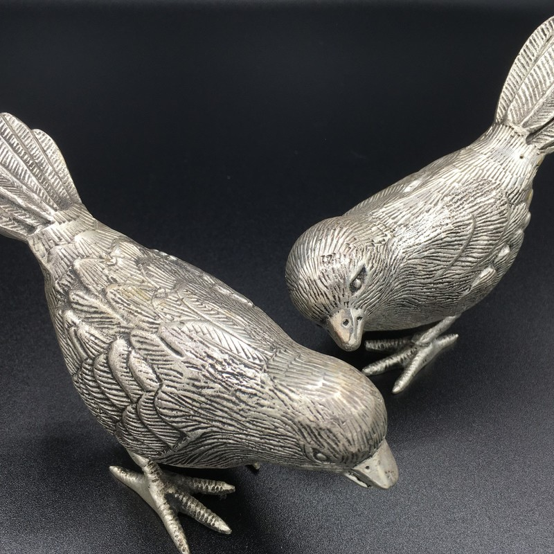 Item #754<br /> Sculpted Silver Birds,<br /> Silver metal<br /> Size -: Set Of 2<br /> Price - 22.00