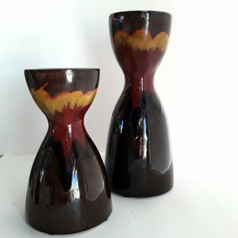 "Set of 2 Ceramic Candle Holders. Rustic colors with a nice glaze.<br /> <br /> Smaller: 4.75x8.5""<br /> Larger: 5x12"""