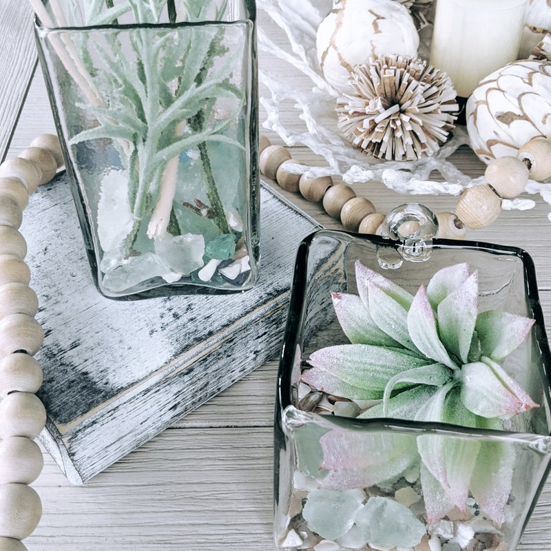 Recycled glass square cube. Can be used as a vase or decorative container. Also; can be hung on a wall; set on a bookshelf or paired with the large and small rectangular cubes to make a cohesive vignette.<br /> Featured at Be Kind Creative Designs