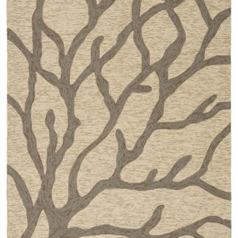 This playful indoor or outdoor area rug showcases a contemporary design and coastal-inspired hues. Mottled gray branches of coral create a graphic statement on the ivory and beige backdrop for beach-worthy style; while the looped pile lends unexpected texture to this durable layer. Free shipping within continental US. Samples available for check out at Sandalwood Shoppes in Leland; NC.