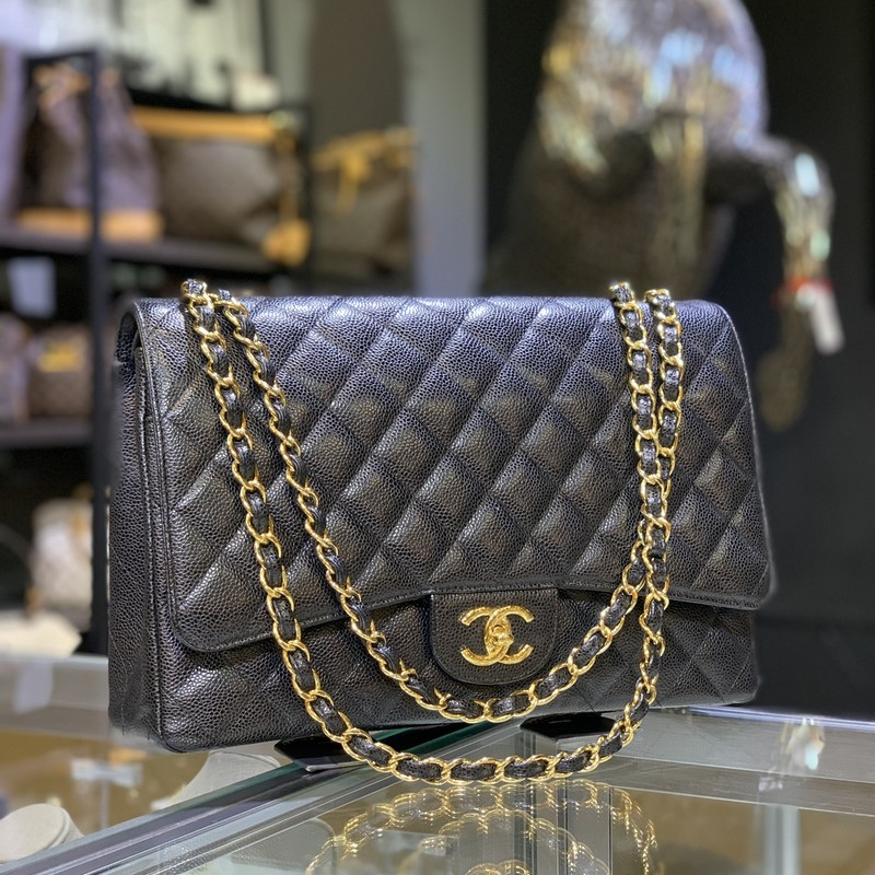 Chanel Dbl Flap Blk Maxi, None, Size: KAHH<br /> <br /> Chanel quilted black caviar leather Maxi Double flap bag with gold hardware.<br /> <br /> HANDBAG DETAILS<br /> BRAND<br /> Chanel<br /> <br /> BAG MODEL<br /> Maxi<br /> <br /> BAG TYPE<br /> Shoulder<br /> <br /> MATERIAL<br /> Caviar Leather<br /> <br /> HARDWARE<br /> Gold<br /> <br /> COLOR<br /> Black<br /> <br /> YEAR MADE<br /> 2000's<br /> <br /> BAG FASTENING & CLOSURE<br /> CC Turnlock<br /> <br /> CONDITION<br /> Very Good
