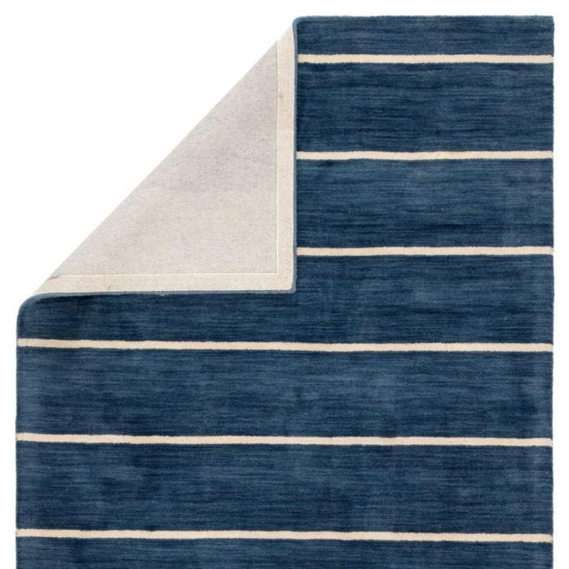 Featuring a bold stripe pattern in a classic colorway; this hand-tufted area rug makes a nautical statement with a dark blue and beige banded design. This wool accent boasts an ultra-durable construction for a timeless addition to transitional spaces. Free shipping  within continental US. Samples available for check out at Sandalwood Shoppes in Leland; NC.